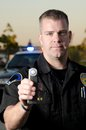 Dui breath test a police officer holds up a machine at a stop Royalty Free Stock Photos