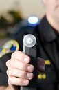 Dui breath test a police officer holds up a machine at a stop Royalty Free Stock Photography