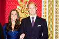 The duke and duchess of cambridge wax figures at madame tussaud s museum in london Royalty Free Stock Images