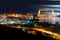 Duluth minnesota night time aerial lift bridge and canal park at on the shore of lake superior Stock Image
