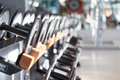 Dumb bells lined up in a fitness studio picture is short focus Stock Photo