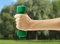 Dumbbell in female hand Royalty Free Stock Photo