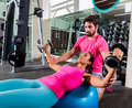 Dumbbell fit ball fly flies opening arms workout chest and personal trainer at gym Stock Photography