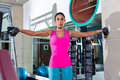 Dumbbell lateral shoulder flies fly girl workout exercise at gym Stock Image