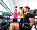 Dumbbell man at gym workout fitness weightlifting Royalty Free Stock Photo