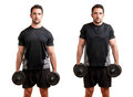 Dumbbell shrugs personal trainer doing for training his trapezius isolated in white Royalty Free Stock Photos