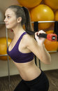 Dumbbell woman weight workout in gym Royalty Free Stock Photo