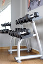 Dumbbells closeup in the gym Stock Photos