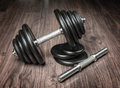 Dumbbells for fitness on a wooden floor Royalty Free Stock Photo