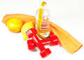Dumbbells fruits water and centimeter sport healthy life concept Stock Photos
