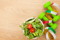 Dumbells, tape measure and healthy food. Fitness and health Royalty Free Stock Photo