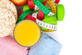 Dumbells, tape measure, healthy food and towels. Fitness and health Royalty Free Stock Photo