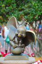 Dumbo statue of in front of cinderella s castle in magic kingdom disneyworld florida Stock Photo