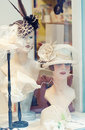 Dummies in a show window of shop female headdresses and accessories Stock Image