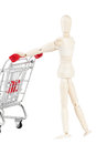 Dummy with shopping cart Royalty Free Stock Photography