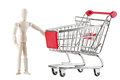 Dummy and shopping cart Royalty Free Stock Image