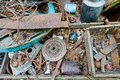 Dump old metal objects in the woods, rusty scrap metal. Environ Royalty Free Stock Photo