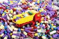 Dump truck toy transported medicine installation on the theme of modern Royalty Free Stock Images