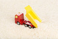 Dump truck toy unload rice grains installation on the theme of agriculture business Stock Image