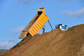 Dump truck unloading soil during road works heavy on the sand Stock Photos