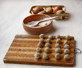 Dumplings on a board and bowl with a flour potato cook table Stock Photos