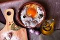 Dumplings ravioli, frozen egg, hand modeling, kitchen garlic, board, flax, bay leaves on top, a beautiful still-life Royalty Free Stock Photo