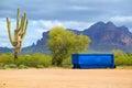 Dumpster bright blue in the arizona desert Royalty Free Stock Image