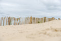 Dune fence on the beach in holland Royalty Free Stock Photography