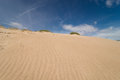 Dune low angle viewpoint take of a against the sky Royalty Free Stock Photo