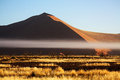 Dune in namibia with mist early morning near sossusvlei Stock Image