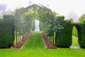 DUNEDIN, NEW ZEALAND - FEBR 10, 2015: foggy morning in the Garden of Larnach Castle. Royalty Free Stock Photo