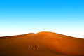 Dunes in desert blue sky and yellow Royalty Free Stock Photography