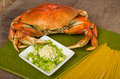 Dungeness crab and ingredients for pasta making on a cutting board Royalty Free Stock Image