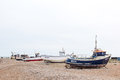 Dungeness england circa june vintage scene with old worn boat seen ashore on a uk beach Royalty Free Stock Photo