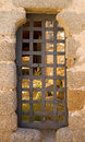 Dungeon door in a medieval stone wall Stock Photography