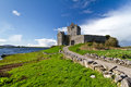 Dunguaire castle at the ocean Royalty Free Stock Photos