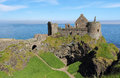 Dunluce castle ruins irish of on the coastal scenic road northern ireland Stock Photos