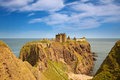 Dunnottar castle aberdeenshire scotland is a spectacular ruined medieval cliff top fortress dating to the fourteenth century and Stock Photo