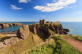 Dunnottar castle with blue sky in stonehaven aberdeen scotland uk Royalty Free Stock Photo