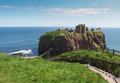 Dunnottar castle scotland near aberdeen in ruins of medieval fortress on a rocky outcrop headland towering above the sea steps Royalty Free Stock Photography