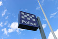 DUNOLLY, VICTORIA, AUSTRALIA - September 19, 2015: The blue-and-white police station sign and flagpole at Dunolly Royalty Free Stock Photo