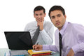 Duo of male executives in office Royalty Free Stock Photography