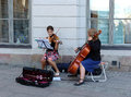 The duo for violin and cello on streets of stockholm Royalty Free Stock Photography