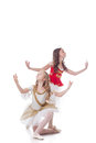 Duo of young artistic ballet dancers isolated on white backdrop Stock Image