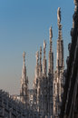 Duomo milano bleu cathedral top italy saint sculptures sky sunny Royalty Free Stock Image