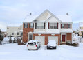 Duplex homes at suburban residential community for two families in winter with snow Stock Photos