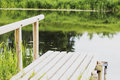 , durable wooden dock on the river for fishing Royalty Free Stock Photo