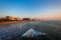 Durban beachfront ocean morning calm waters at from south beach looking north to the distant football soccer stadium great weather Stock Images
