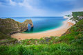 Durdle Door and the beach on the Jurassic Coast of Dorset Royalty Free Stock Photo