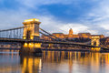Dusk at bridge on Danube river with lights Royalty Free Stock Photo